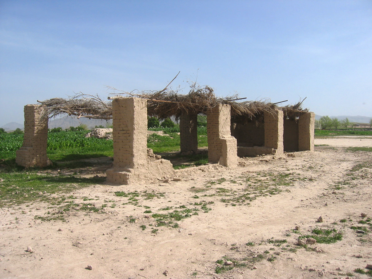 Uruzgan featured very little school buildings prior to the ISAF intervention. Although basic 'education' was being facilitated in private houses, mosques, or in open-air structures, as seen here.