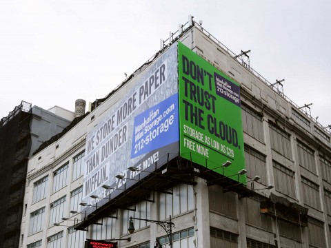 "A billboard advertisement for Manhattan Mini-Storage. The green background and mention of ""the cloud"" is a direct reference to MakeSpace. Via Business Insider & MakeSpace"