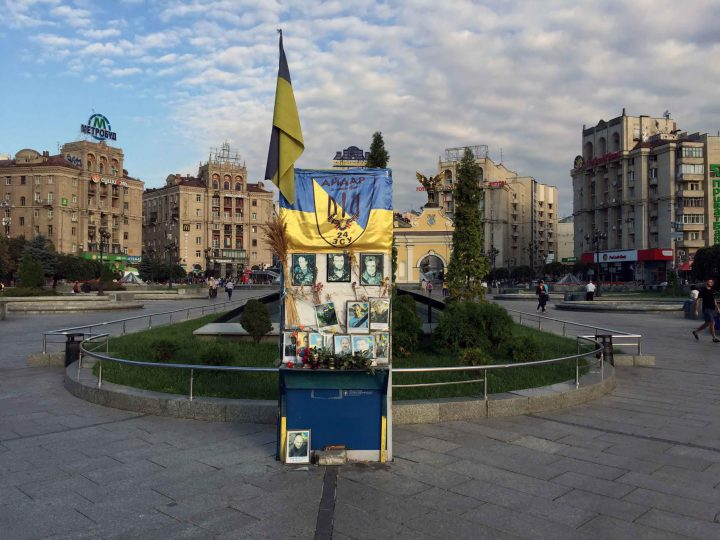 An informal monument to the heroes of the Euromaidan in 2013, situated on the central square (Maidan) in Kiev. In the background buildings from soviet times.