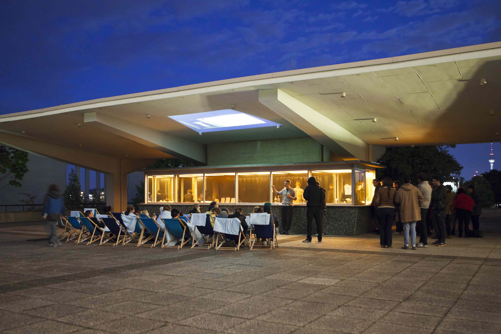 """19 Hours at the Kiosk, a project by Studio Miessen as part of the exhibition """"Between Walls and Windows:Architecture and Ideology"""", commissioned and produced by Haus der Kulturen der Welt, Berlin, 2012;weekly evening program including discussions, presentations, performances, reading groups, barbecues and drinks. Photography by Judith Affolter and Thomas Eugster."""