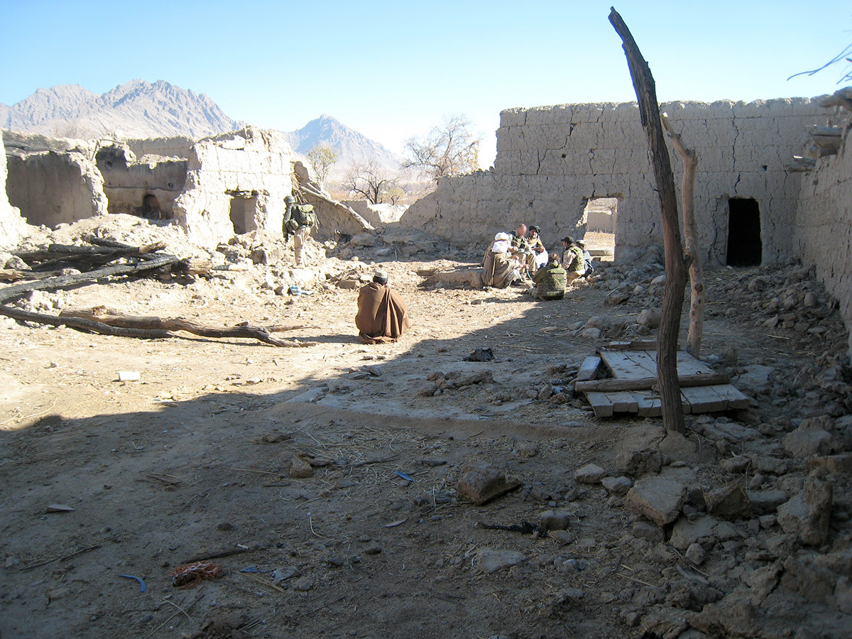 Three 500-pound bombs obliterated a Qala, the Pashto name for house, in Spin Ghar when the Taliban used the structure to attacked ISAF forces. Here, the owner receives financial compensation for the damage of property and livestock.